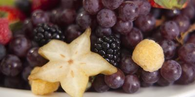 close-up of fruit tray featuring star fruit and blackberries