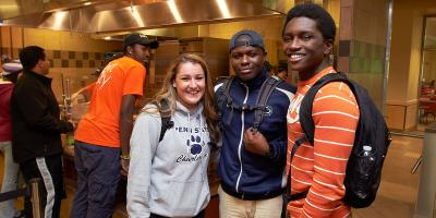 Three Penn State students standing in Port Sky