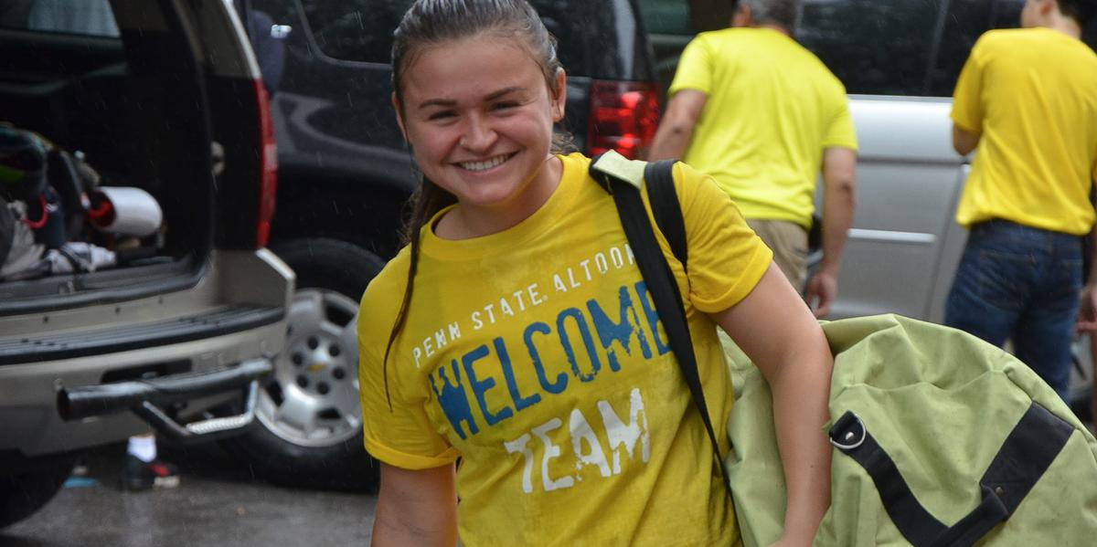 Welcome Team member smiling in the rain